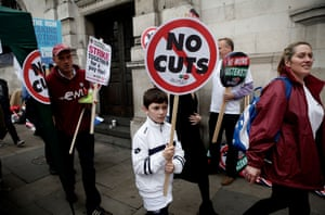 A young boy carries a sign on the march between Embankment and Hyde Park.