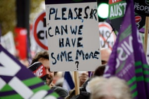 A man holds up a placard during the march organised by The Trades Union Congress (TUC).