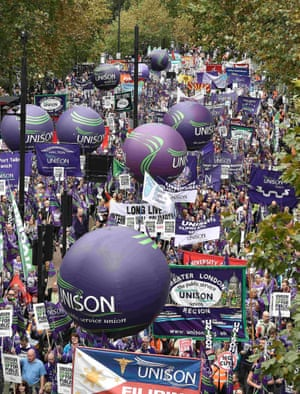 UNISON balloons, placards and banners are carried through central London.