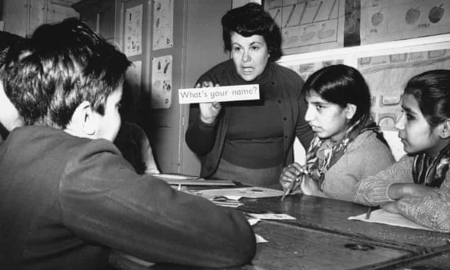 A teacher giving English lessons to immigrant children from India and Pakistan at a school in Walsall, Staffordshire, in 1969.