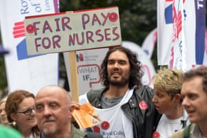 Comedian Russell Brand marches with the Royal College of Nursing.