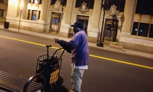 A homeless man walks the streets in Bridgeport, Connecticut.