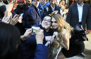 Cara Delevingne poses with her fans