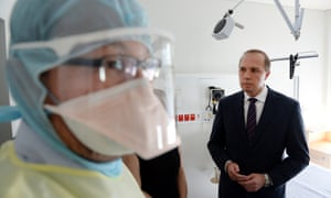 Peter Dutton with a nurse in protective gear during a visit to the Royal Brisbane hospital in Brisbane.