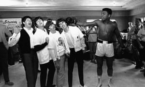 Clay poses with The Beatles who were in New York in 1964 for an appearance on the The Ed Sullivan Show. Clay was preparing for his world heavyweight title fight with Sonny Liston.