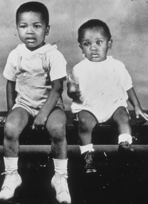 A young Cassius Clay is pictured (left) with his younger brother.