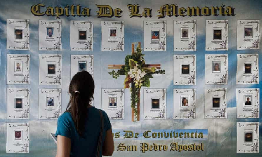 A banner with pictures of victims of violence in Buenaventura
