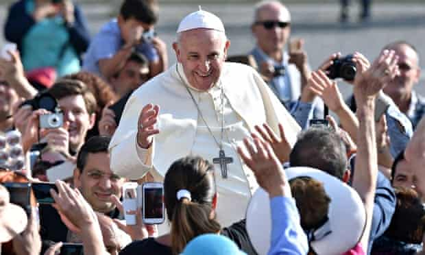 The pope smiles broadly as he greets crowds in St Peter's Square, Vatican City