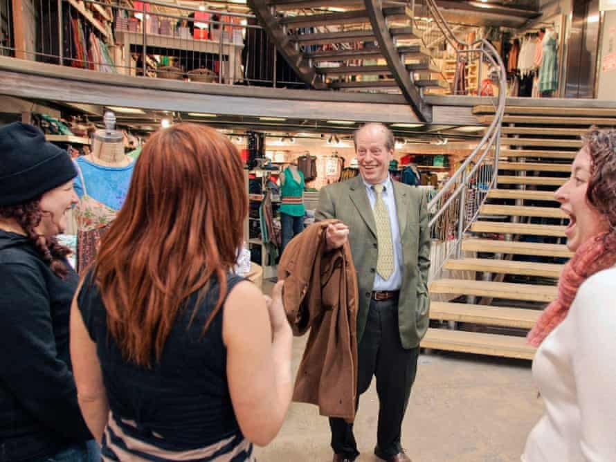 Richard A. Hayne, founder and chairman of Urban Outfitters jokes with employees inside a store in Philadelphia in 2006