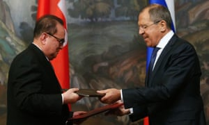 Russian Foreign Minister Sergei Lavrov (right) and his North Korean counterpart Ri Su-yong exchange documents in Moscow this week.
