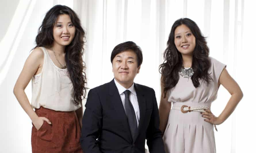 Do Won Chang and wife, Jin Sook (centre and right)