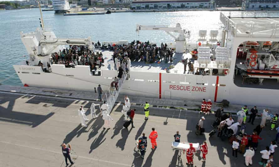 People disembark from a boat at the Brindisi harbour