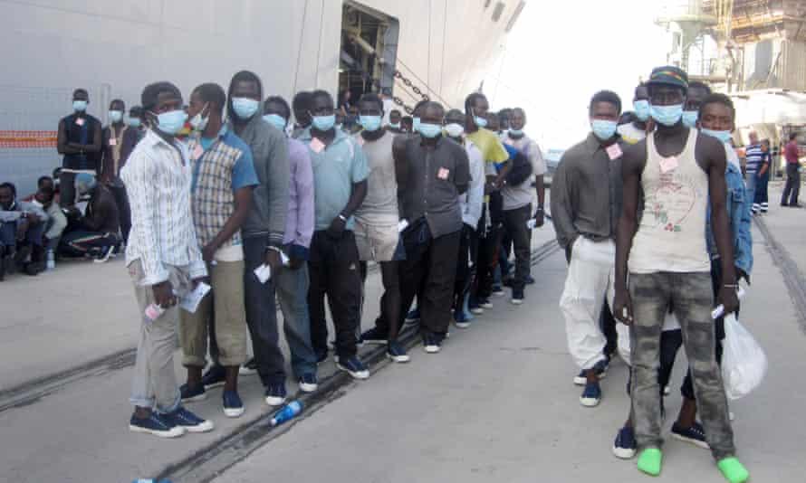 Migrants disembark in Reggio Calabria, Italy.