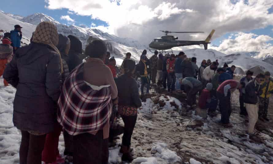 A Nepalese army helicopter rescues survivors of a snowstorm in Manang district.