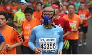 "Many runners wore face masks to protect themselves against the ""hazardous"" levels of smog during the Beijing International Marathon."