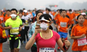 A runner wearing a mask during the Beijing International Marathon.