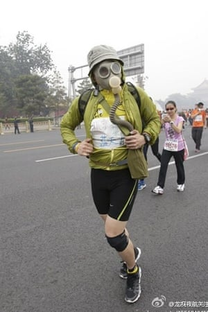 Runners wore a selection of face masks including this runner wearing an old-style gas mask.