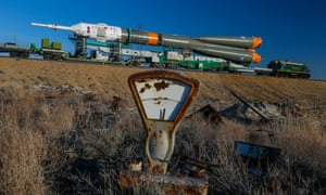 A rocket carrier with the 'Soyuz TMA-08M' spacecraft is moved to a launch pad behind an old weighing machine at the Baikonur cosmodrome in Kazakhstan, in March 2013.
