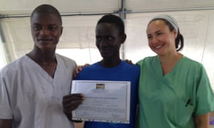 An Ebola survivor with a certificate of discharge