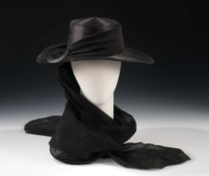 A black straw and silk mouring hat from around 1915.