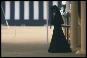 Crown Princess Michiko wearing mourning clothing after meditating before Emperor Hirohito's coffin.