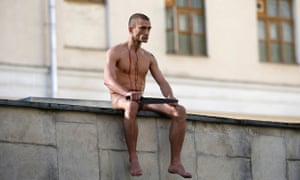 Pyotr Pavlensky on the wall of the Serbsky psychiatry   centre after he sliced off part of his earlo
