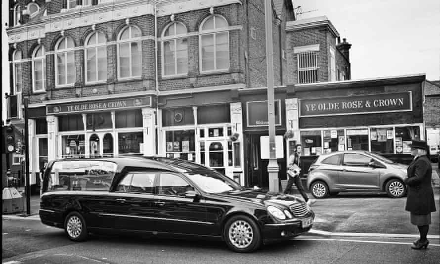The state-funded hearse for the homeless 'Doc', outside Ye Olde Rose and Crown, where he was well known. Photograph: Sarah Lee for the Guardian