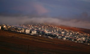 Tracer rounds light the sky over the Syrian town of Kobani during an airstrike, seen from the Mursitpinar crossing on the Turkish border