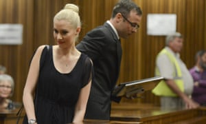 Oscar Pistorius makes his way past his ex-girlfriend Samantha Taylor as he arrives in the Pretoria high court.