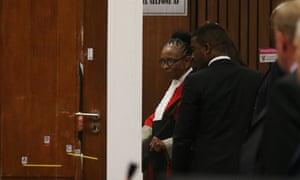 Judge Thokozile Masipa examines the toilet cubicle during Tom Wolmarans' testimony on 9 May.