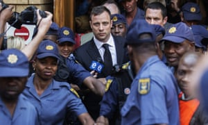 Oscar Pistorius leaves court after he was found guilty of culpable homicide.