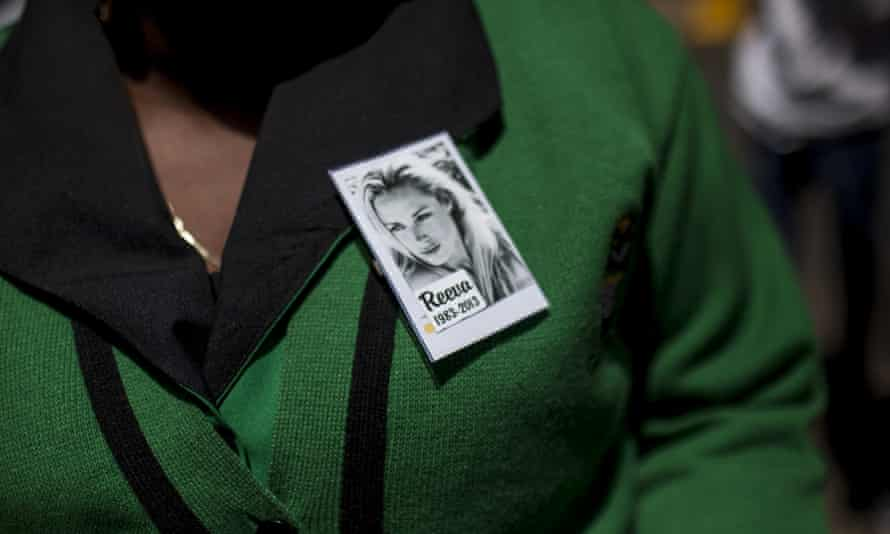 A member of the ANC Women's league wears a pin for Reeva Steenkamp.