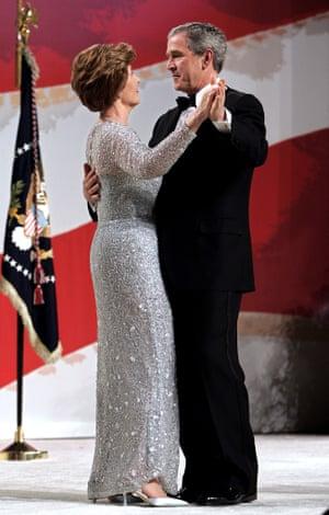 George W. Bush and Laura Bush at the Commander in Chief Ball 2005. Laura is wearing an Oscar De La Renta dress.