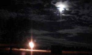 Wilga Park, Narrabri gas flare against the super moon in August.