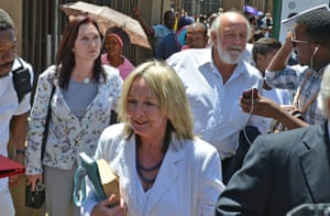 Parents of the late Reeva Steenkamp, June, front, and Barry back, leave court in Pretoria, South Africa, after Oscar Pistorius was handed down a five-year sentence.
