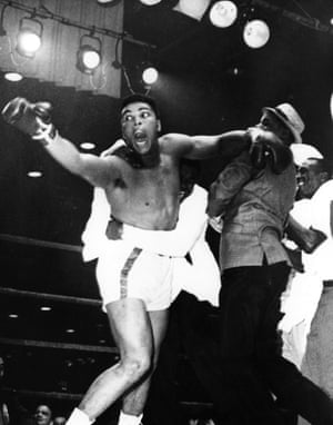 Clay thrashes around in delight after beating Sonny Liston in the seventh round of their 1964 fight to become the heavyweight champion of the world. He can be seen yelling 'eat your words' to the press corps who had belittled his chances of victory prior to the fight.