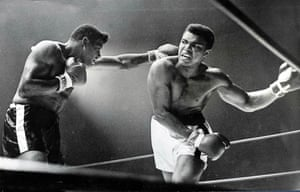 Ali evades a left hand jab from Floyd Patterson in their 1965 bout. Clay retained his title by technical knock-out in the 12th round.