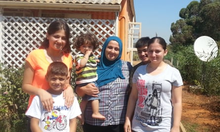 Layali ibrahim (right) with her brothers, sister and mother, Avin, who is holding 15-month-old Omar.