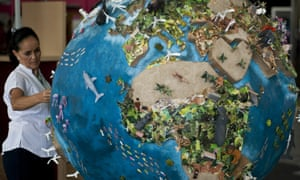 A woman looks at a globe model in the climate village during the United Nations Framework Convention on Climate Change (COP-16), in Cancun, 2010.