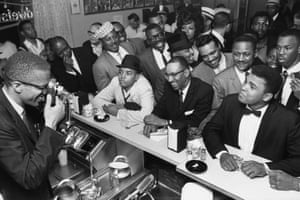 Clay celebrates with Malcolm X. Rumours had already circulated that Clay had joined the National of Islam religious movement, and he finally declared them to be true the day after beating Liston.