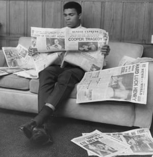 Ali reads the Sunday Express newspaper after demolishing Henry Cooper in their second fight in 1966.