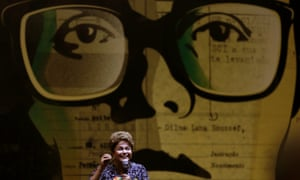 Dilma Rousseff speaking at a rally before a picture of her as a Marxist student activist, when she was tortured by the military dictatorship.