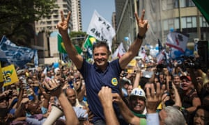 Aécio Neves greets supporters while campaigning at Copacabana beach in Rio de Janeiro.