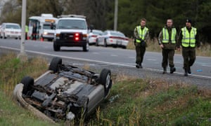 Quebec officer investigates an overturned vehicle in Saint-Jean-sur-Richelieu