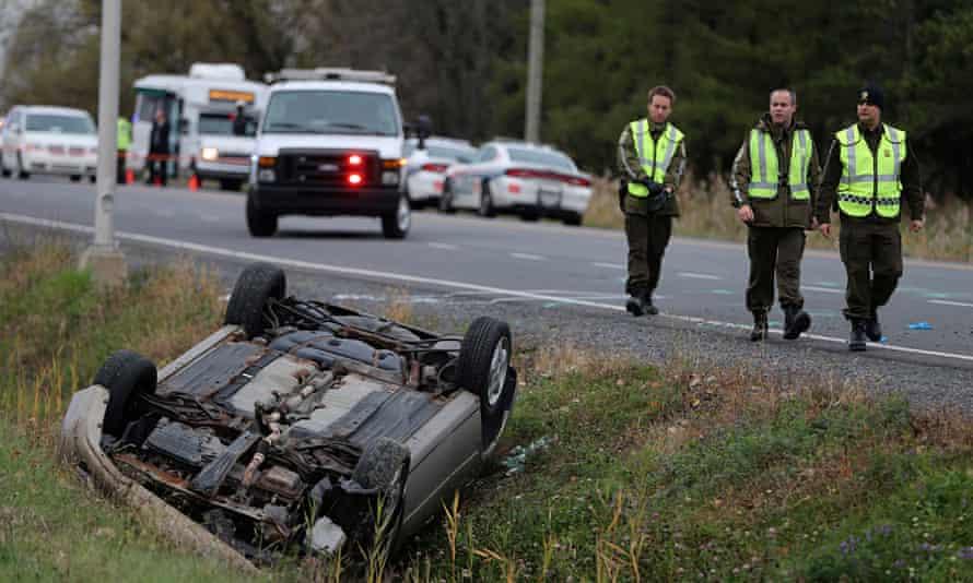 Quebec officer investigates an overturned vehicle in Saint-Jean-sur-Richelieu