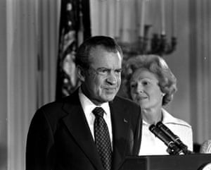 President Richard M. Nixon and his wife Pat Nixon are shown standing together in the East Room of the White House