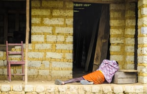 A man suffering from Ebola virus lies on the floor on the outskirts of Freetown, Sierra Leone