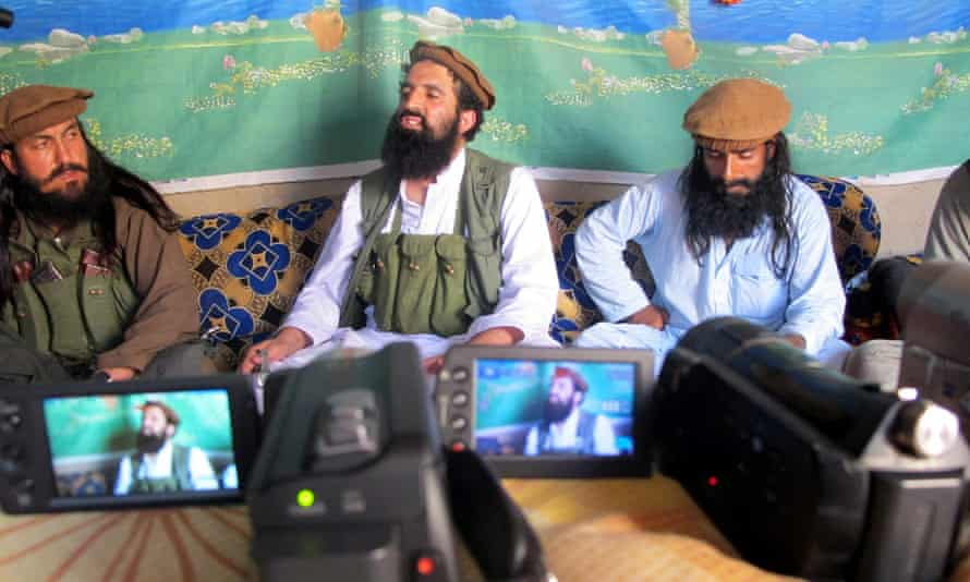 Shahidullah Shahid, centre, then spokesman of the Pakistani Taliban, speaks to reporters in February