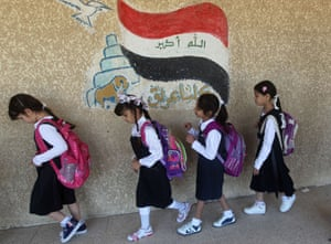Children walk to class on the first day of the new semester. Schools were delayed a month because many were being used as shelters for displaced families fleeing the Islamic State group. The UN says an estimated 1.8 million Iraqis have been displaced by violence in the country this year