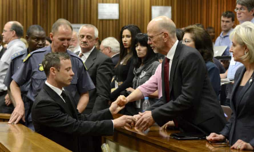 Oscar Pistorius led away to police cells